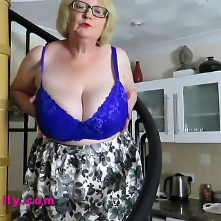 Gorgeous busty Granny comes down the stairs in her stockings