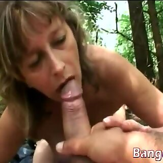 Granny Juditta bouncing on long dong in woods