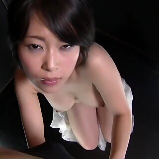 Big titty Asian slut gives a sexy POV blowjob