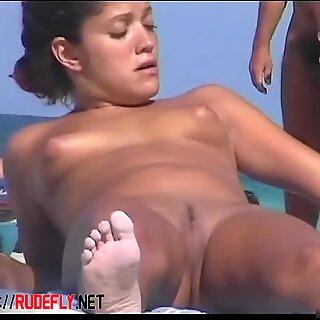 Beautiful Nude sunbathes thenputs her bikini knickers back