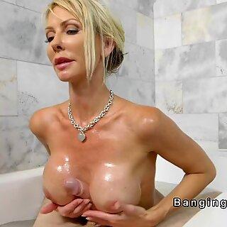 Huge tits Milf wanks huge dick in bathtub