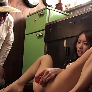 Asian with a hairy vagina pleases with a carrot