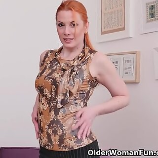 Small titted redhead milf Michelle fingers her pussy