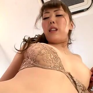 Japanese Amazon with a piercing smile sucks two cocks at the same time.