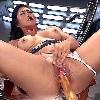 Busty Asian takes dp fucking machine